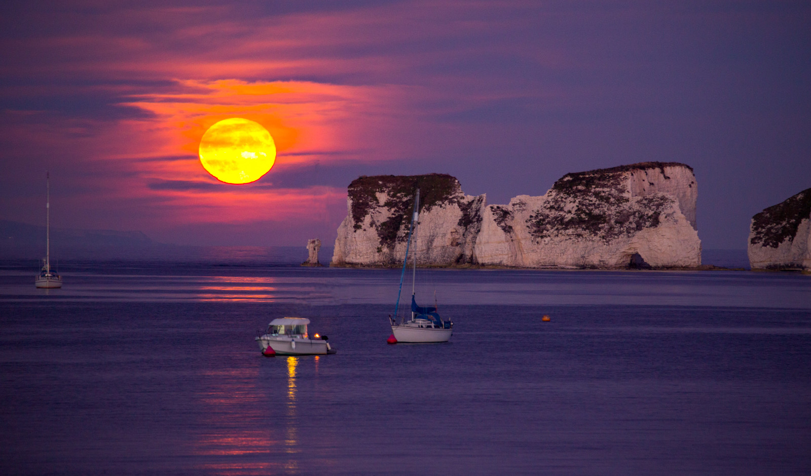 Harvest Moonrise over Old Harry rocks in Dorset